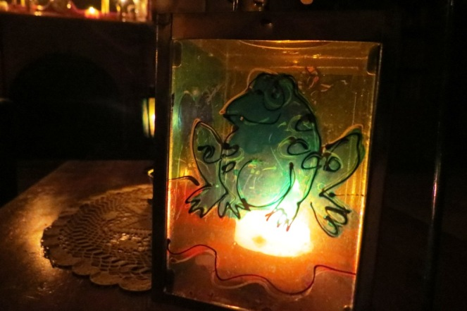 Mr. Frog, all aglow in the candlelight.
