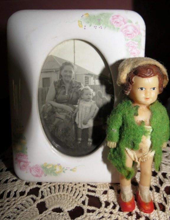 My mum and me. This tiny doll stands at only three inches tall and was saved by my mum for many years after I had finished playing with it.